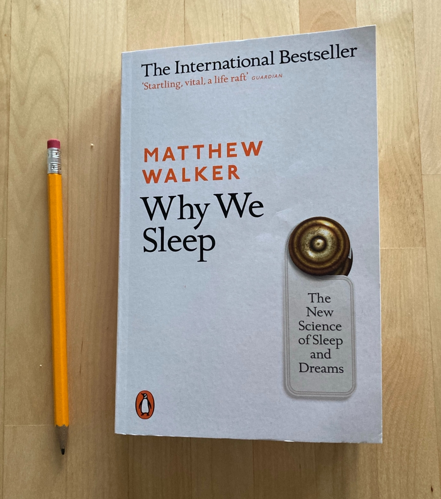 Book Why We Sleep by Matthew Walker on a table next to a pencil